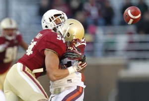 Nov 17, 2012; Boston College Eagles line backer Nick Clancy (54) hits Virginia Tech Hokies running back Tony Gregory (22) as he fails to catch the ball. Credit: Greg M. Cooper-US PRESSWIRE