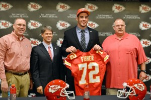 Kansas City Chiefs first round draft pick offensive tackle Eric Fisher (72) poses for a picture with head coach Andy Reid (right), chairman Clark Hunt (second from left) and general manager John Dorsey (far left) during a press conference at the Kansas City Chiefs Training Complex. Mandatory Credit: Peter G. Aiken-USA TODAY Sports