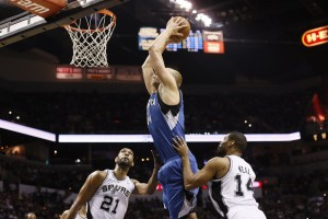 Apr 17, 2013; San Antonio, TX, USA; Minnesota Timberwolves center Greg Stiemsma (34) dunks as San Antonio Spurs forward Tim Duncan (21) looks on during the second half at the AT&T Center. The Timberwolves won 108-95. Mandatory Credit: Soobum Im-USA TODAY Sports